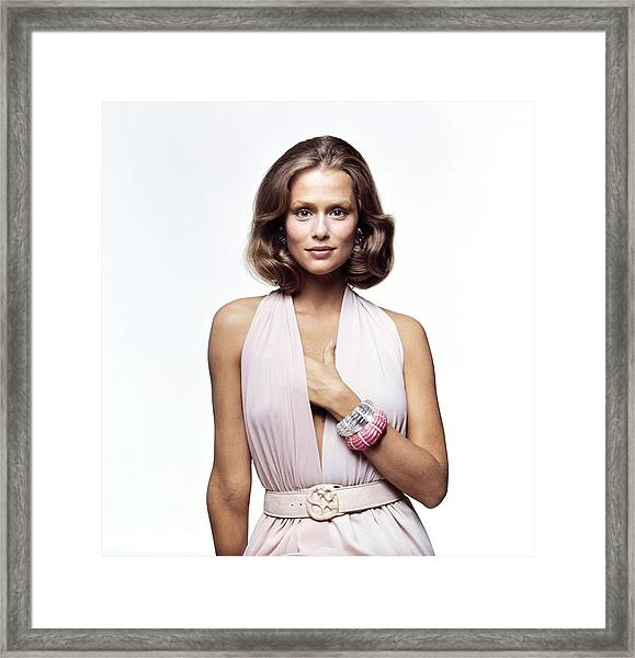 Lauren Hutton Wearing A Galanos Dress Framed Print by Bert Stern