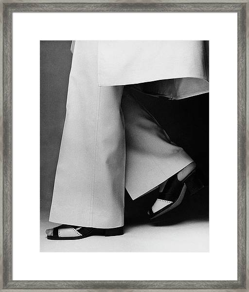 Lauren Hutton's Legs Wearing Calvin Klein Pants Framed Print by Francesco Scavullo