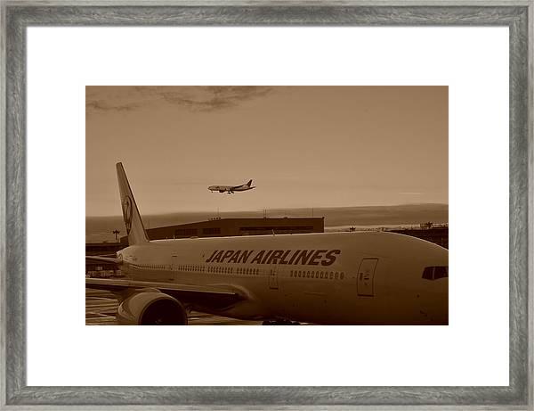 Leaving Japan Framed Print