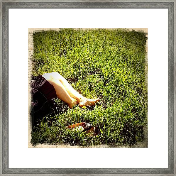 Legs Of A Woman And Green Grass Framed Print