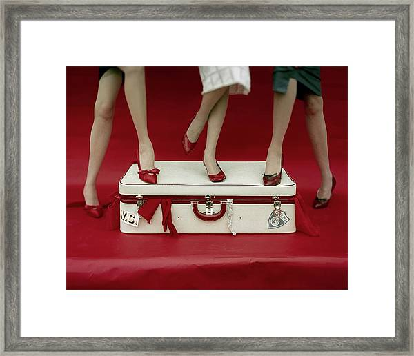 Legs Of Models Standing On A Suitcase Framed Print by Sante Forlano