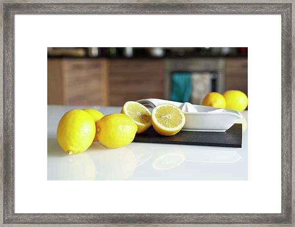 Lemons And Juicer On Kitchen Counter Framed Print