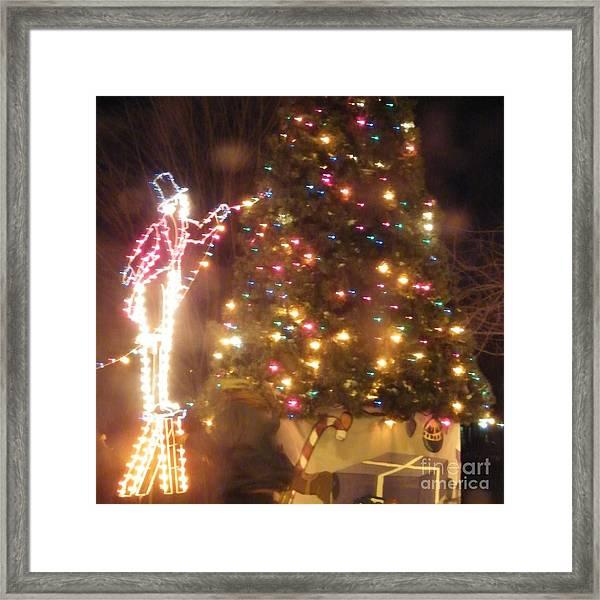 Lighted Decorating Of Tree Framed Print