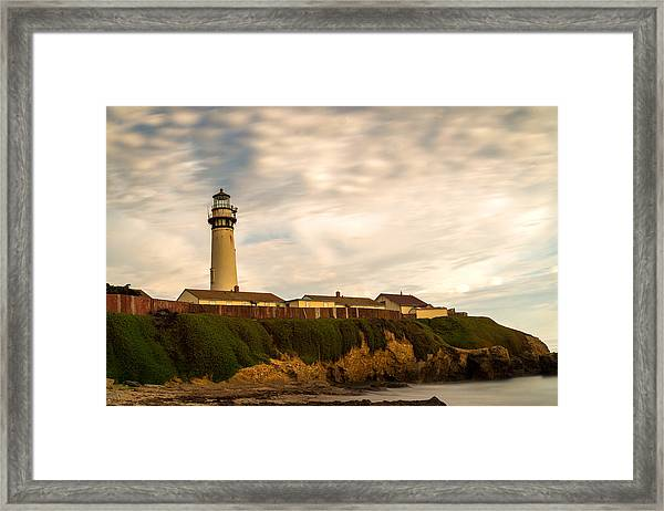Lighthouse And Clouds Framed Print