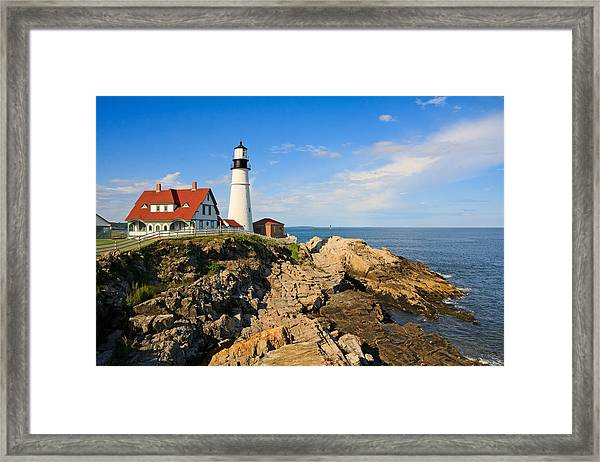 Lighthouse In The Sun Framed Print