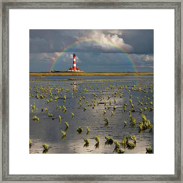 Lighthouse Meets Rainbow Framed Print by Carsten Meyerdierks
