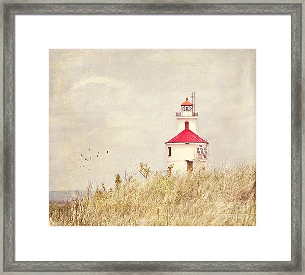 Lighthouse With Red Roof Framed Print