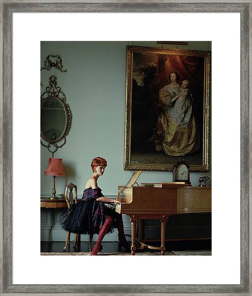 Linda Evangelista At A Piano Framed Print