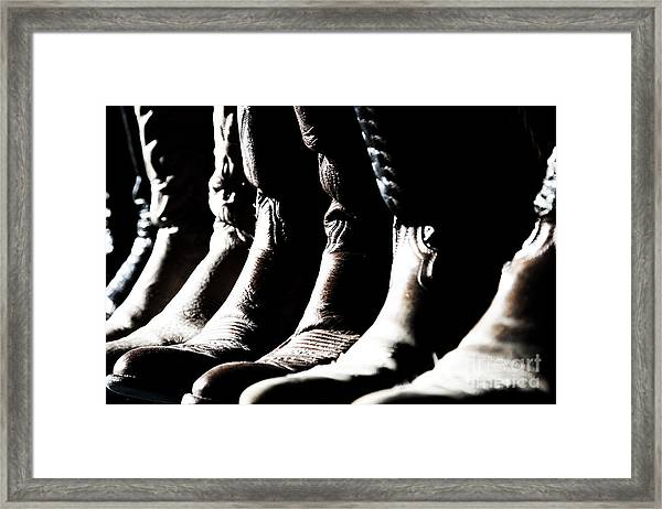 Line Of Cowboy Boots In Sunlight Framed Print