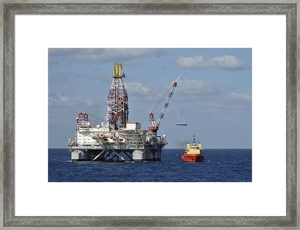 Loading Oil Pipe Framed Print