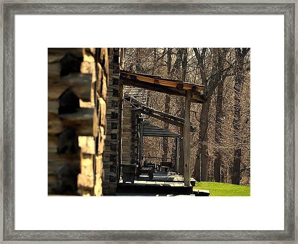 Log Cabins Framed Print