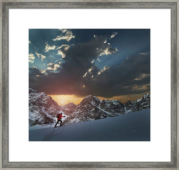 Lone Climber On A Snowy Slope At Sunrise Framed Print