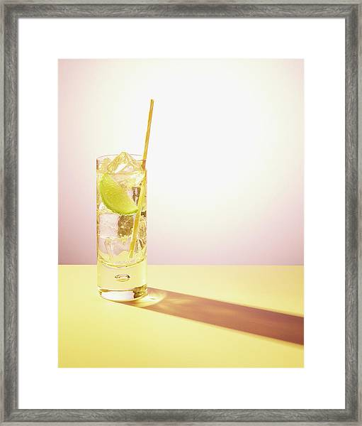 Long Drink In Glass With Lime And Straw Framed Print by Felicity Mccabe