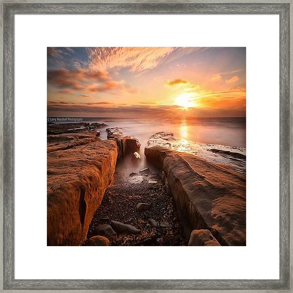 Long Exposure Sunset At A Rocky Reef In Framed Print by Larry Marshall