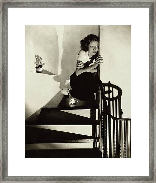 Loretta Young Sitting On A Staircase Framed Print