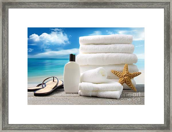 Lotion  Towels And Sandals With Ocean Scene Framed Print