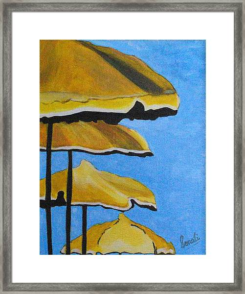 Lounging Under The Umbrellas On A Bright Sunny Day Framed Print