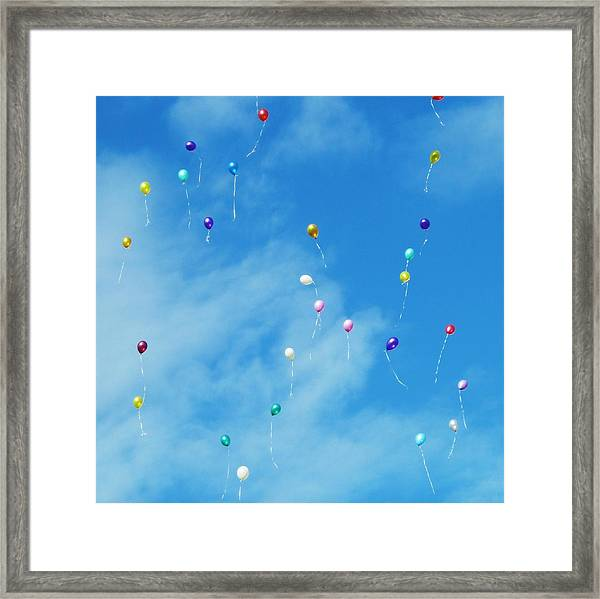 Low Angle View Of Balloons Flying Against Sky Framed Print by Alexey Ivanov / EyeEm