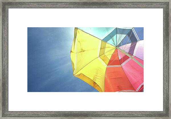 Low Angle View Of Colorful Parasol Framed Print