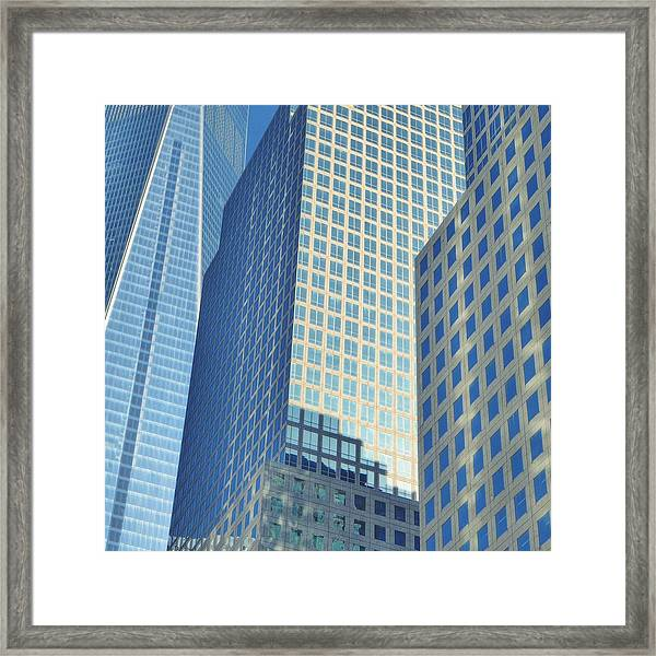 Low Angle View Of Office Buildings Framed Print