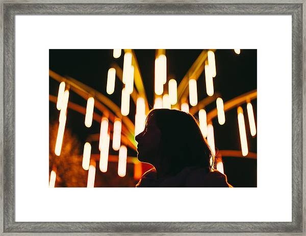 Low Angle View Of Silhouette Woman Against Illuminated Lights At Night Framed Print by Adriana Duduleanu / EyeEm
