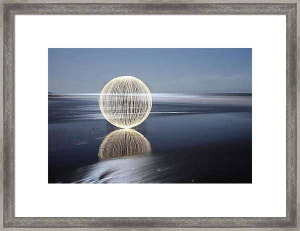 Low Tide Reflection Framed Print by Andrew John Wells