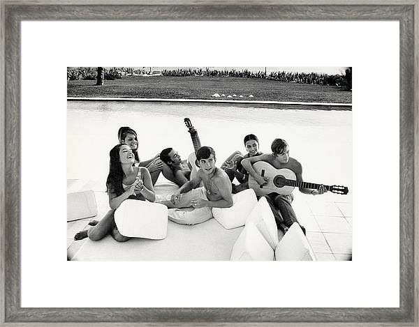 Luis And Alvaro Figuerro Hanging Out With Friends Framed Print