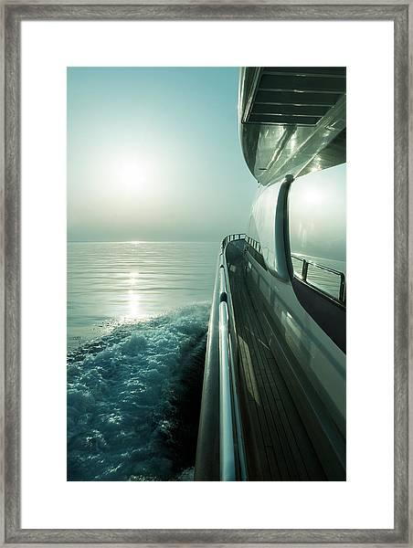 Luxury Motor Yacht Sailing At Sunset Framed Print