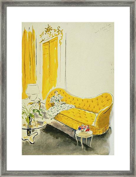 Madame Luce On A Yellow Sofa Framed Print
