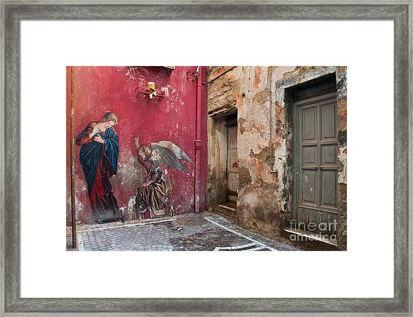 Madonna Of The Alley Framed Print