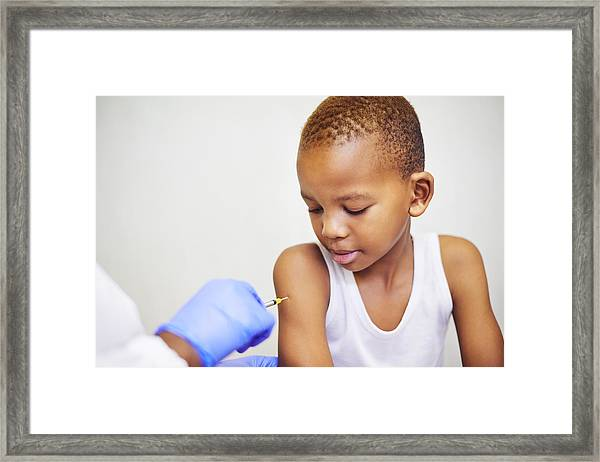 Making Sure He Stays Healthy Framed Print by Mapodile