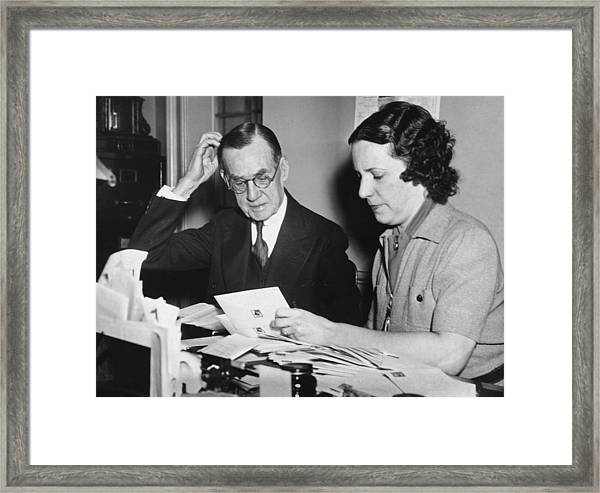 Man Assisted By His Secretary Framed Print