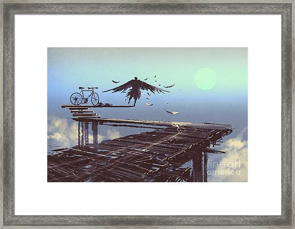 Man Becomes Bird Standing On End Of Framed Print by Tithi Luadthong