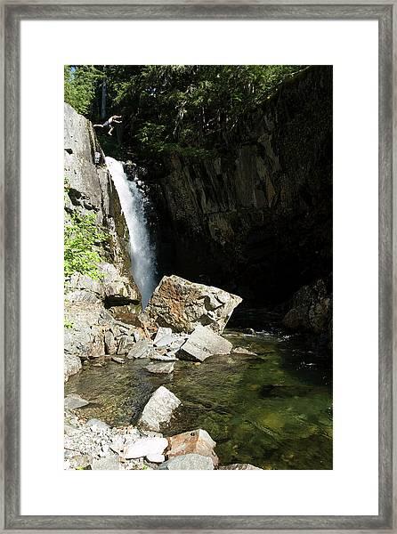 Man Jumping Off Waterfall In Idaho Framed Print