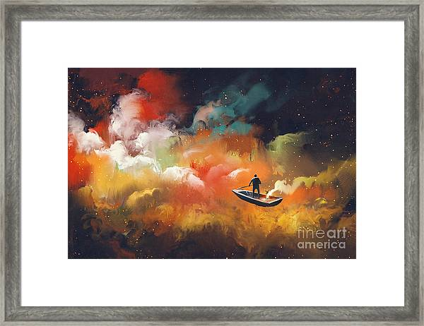 Man On A Boat In The Outer Space With Framed Print