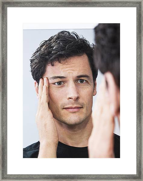 Man Pulling One Side Of His Face, Facelift Or Not? Framed Print by Dimitri Otis