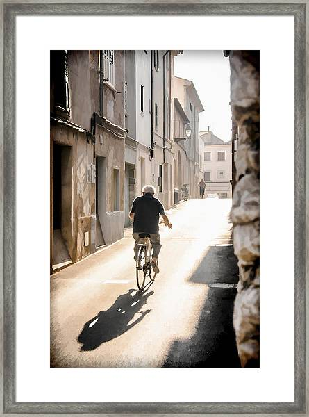 Man Riding Bicycle In Street In Puerto Pollenca Framed Print