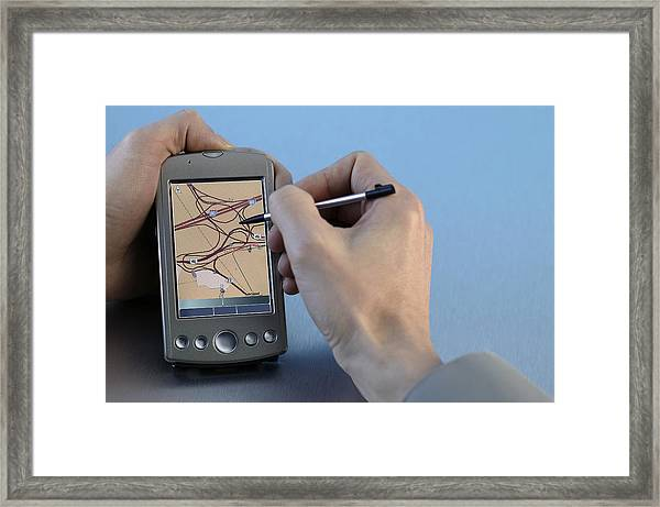 Man Using Gps System Framed Print by Comstock
