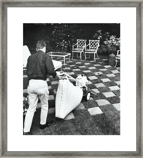 Man Using Lawn Vacuum Framed Print