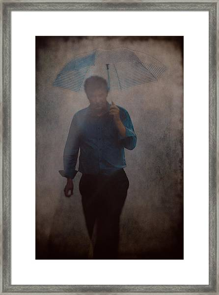 Man With An Umbrella Framed Print