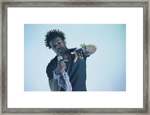 Man With Microphone Framed Print by Comstock