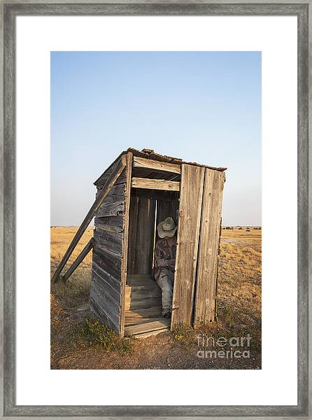Mannequin Sitting In Old Wooden Outhouse Framed Print