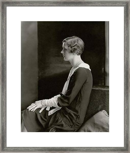 Marilyn Miller Sitting On A Chair Framed Print