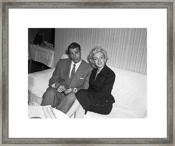 Marilyn Monroe And Joe Dimaggio Framed Print