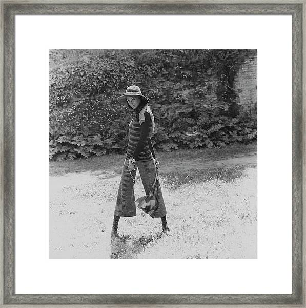 Marisa Berenson Wearing A Sweater And Pants Framed Print