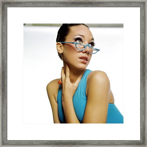 Marisa Berenson Wearing Blue Glasses Framed Print by Bert Stern