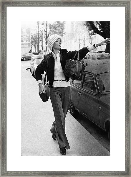 Mary Russell Hailing A Cab Framed Print