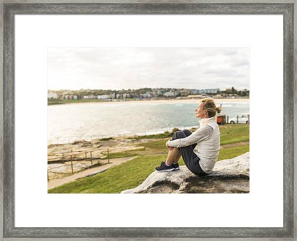 Mature Woman Enjoying The Ocean View Sydney Australia Framed Print by OwenPrice