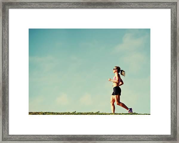 Mature Woman Jogging Outdoors Framed Print