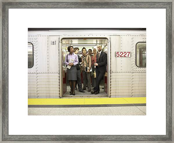 Medium Group Of People Standing In Subway Train Doorway Framed Print by Darrin Klimek